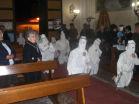 Battenti inginocchiati in chiesa