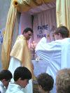 Il parroco don Pino davanti alla chiesetta di San Bernardino